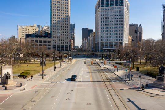 At 4:30 p.m. on Tuesday, March 17, 2020, almost one week after the first confirmed cases of coronavirus in Michigan were reported, Woodward Avenue is nearly deserted. Many people are temporarily out of work or working from home to limit exposure to the Covid-19 virus.