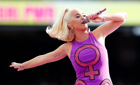 "In this Sunday, March 8, 2020, file photo, Katy Perry performs before the start of the Women's T20 World Cup cricket final match in Melbourne. A federal judge has given Perry a major victory in the dispute over her song ""Dark Horse,"" overturning a jury's verdict that found the pop superstar and her collaborators copied the 2013 hit from a 2009 song by Christian rapper Marcus Gray."