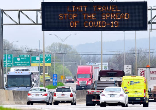 This Tennessee Department of Transportation's dynamic message sign, on Interstate 24 west, in Chattanooga, Tenn., is encouraging people to limit travel during the COVID-19 outbreak Tuesday, March 18, 2020.