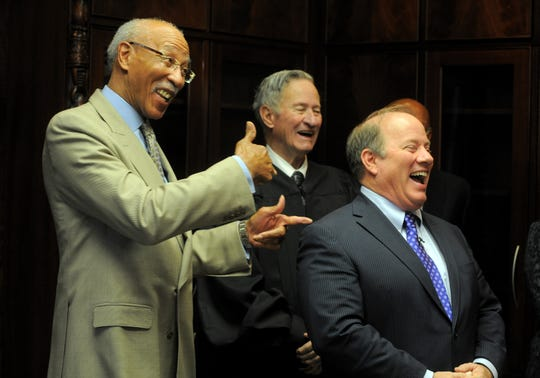 Retired Senior Judge Patrick Duggan, at the 2014 swearing-in of his son, Mayor Mike Duggan, right, with former Mayor Dave Bing. The judge died Wednesday, March 18, 2020.