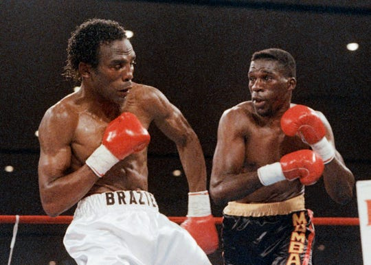Roger Mayweather, right, follows through with a right to Harold Brazier during the third round of their WBC super lightweight championship bout in 1988.