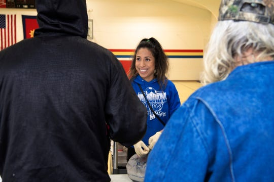 Marissa Powless, center, serves lunches to the needy at the Salvation Army Wednesday morning, March 18, 2020. Poweless is a new volunteer who answered the bell when she heard many of the older volunteers had to stay home since they are at a higher risk for the coronavirus COVID-19.
