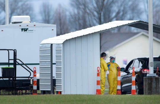 The action was slow at the new Deaconess drive-through coronavirus testing site at Green River and Lynch roads on its first day in operation, but some people were able to get tested for the virus after meeting a stringent list of conditions Wednesday, March 18, 2020.