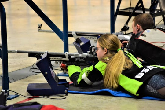 Claudia Muzik, 13, of Green Springs, competes in an air rifle competition as part of the Civilian Marksmanship Program at Camp Perry on March 14.