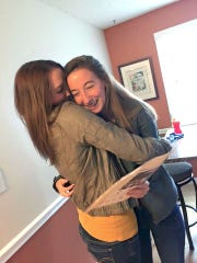 Emily, right, receives her acceptance letter from FGCU and a hug from her sister, Jackie, in April of 2016. FGCU was the only college Simpson, who is from Bradenton, applied to.