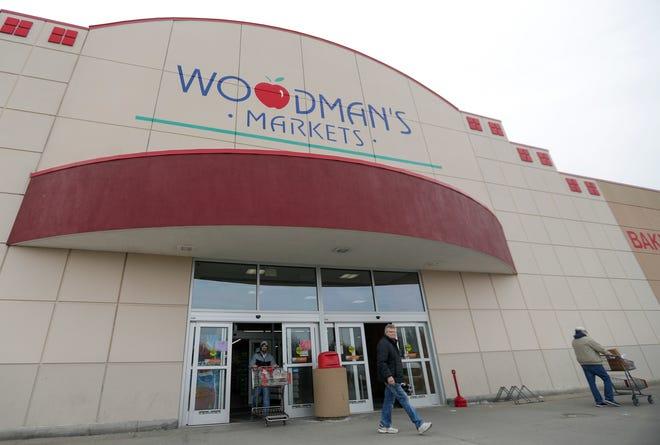Customers leave Woodman's Markets in Howard in March.