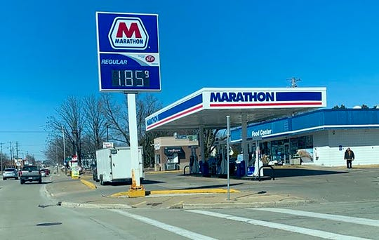 The Marathon gas station prices have dropped to $1.85 per gallon on Tuesday, March 17, 2020, located at 952 W. Mason St, Green Bay, Wis.