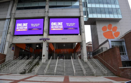 "Digital message boards flashes ""Online Instruction COVID019 Update and online instruction through April 5"" near the IPTAY office at Memorial Stadium in Clemson Wednesday, March 18, 2020."