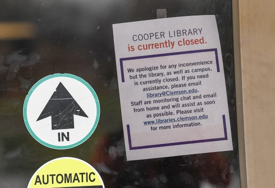 A sign at the Cooper Library telling students it is currently closed Wednesday, March 18, 2020.