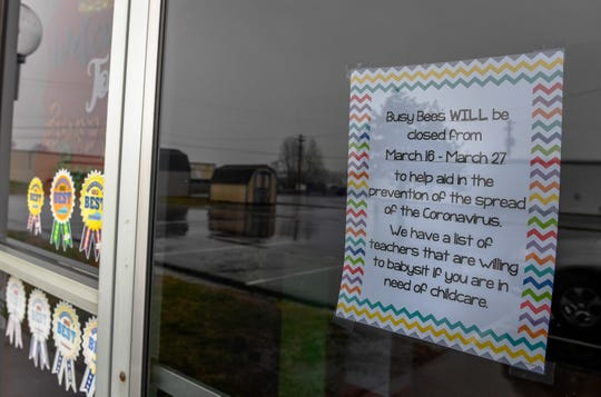 A sign on the door of the now closed Busy Bees daycare center as, by executive order issued by the Governor, all Kentucky daycare centers will have to close by Friday due to the coronavirus pandemic Wednesday, March 18, 2020.