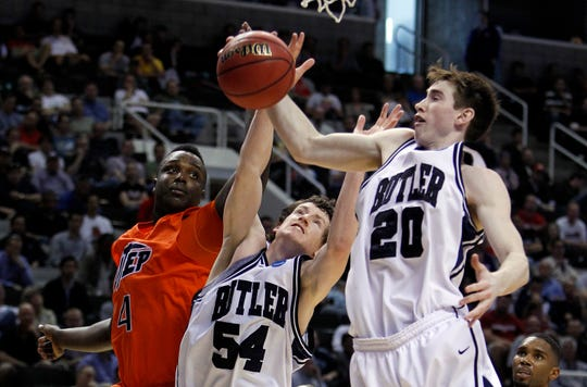 Butler's Gordon Hayward and Matt Howard get this rebound from UTEP's Derrick Caracter in second half action. In NCAA Mens Basketball West Region action the #5 seed Butler mens basketball team defeated #12 seed UTEP 77-59 at the HP Pavilion in San Jose, CA on Thursday, March 18, 2010. Butler will move on to play Murray State Saturday. (Sam Riche / The Indianapolis Star)