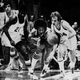 Muncie Central's Tony Bridges (21) and Jack Moore (14) scramble with Terre Haute South's Richard Wilson for a loose ball during the 1978 IHSAA state basketball finals.