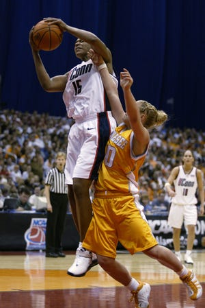 29 Mar 2002:  Asjha Jones #15 of Connecticut pulls down the rebound before April McDivitt #10 of Tennessee  during the NCAA Women's Final Four game at the Alamo Dome in San Antonio, Texas. Connecticut won 79-56. DIGITAL IMAGE. Mandatory Credit: Andy Lyons/Getty Images