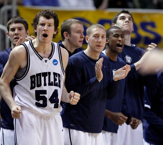 Butler's Matt Howard celebrates a second half basket on the bench. In NCAA Mens Basketball West Region second round action the #5 seed Butler mens basketball team defeated the #12 seed Murray State mens basketball team 54-52 at HP Pavilion in San Jose, CA on Friday, March 19, 2010. Butler moves on to the sweet 16 in Salt Lake City. (Sam Riche / The Indianapolis Star)