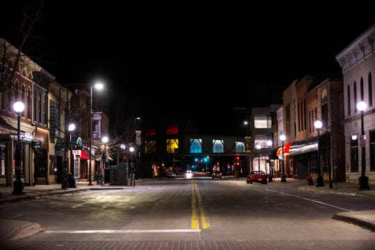 Dubuque Street is empty following a state of emergency being declared in Iowa for coronavirus, COVID-19, closing bars and restaurants on St. Patrick's Day, Tuesday, March 17, 2020, in downtown Iowa City, Iowa.