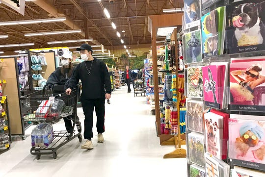 Shoppers at Wegmans in Ithaca wear masks to help reduce exposure to coronavirus. March 18, 2020.