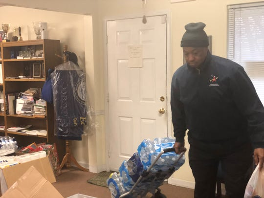 Jackson-Madison County School System Superintendent Ray Washington drops off donations from system's students and families. The Jackson-Madison County NAACP delivered the cases of water, stacks of paper products and boxes of hygiene and cleaning products to Nashville for tornado relief.