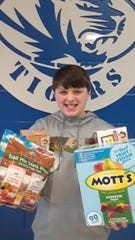 Northside Elementary fifth grader Eli Moore organized a donation drive in Hardin County to benefit the tornado victims in Middle Tennessee.