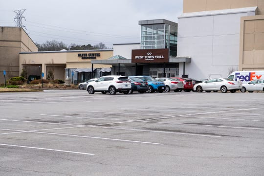 Few cars fill the parking lot at Knoxville's West Town Mall on Wednesday, March 18, 2020.