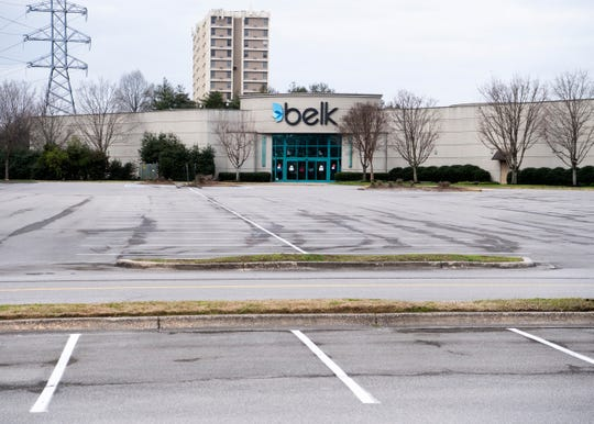 No cars are in sight at the parking lot for the men's Belk at West Town Mall on Wednesday, March 18, 2020.