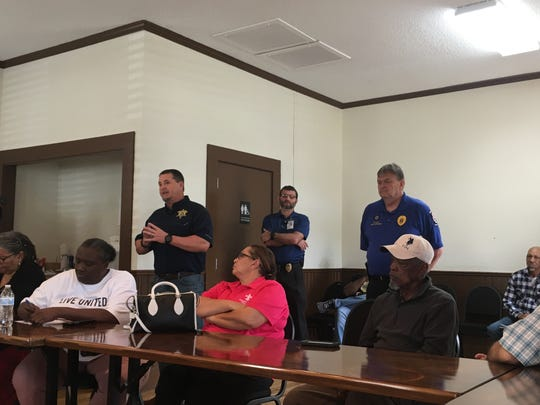 Capt. Drew David, public information officer with the Vermilion Parish' Sheriff's Office, and Abbeville Police Chief Bill Spearman talk about law enforcement efforts to fight violent crime in Abbeville at a community meeting March 12.