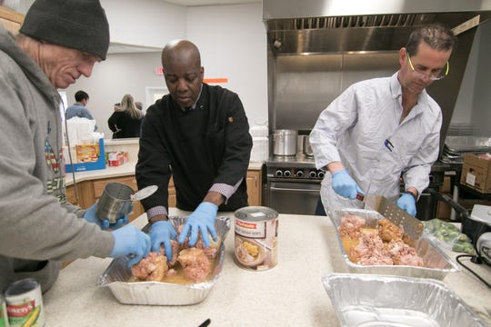 From left, Duane Mullin, Chef Gerald Parker and Glen Shack prepare a broccoli stew at Bountiful Harvest Wednesday, March 18, 2020, part of the food being offered for those in need, particularly during the coronavirus pandemic.