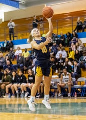 Hartland's Nikki Dompierre drives to the hoop in a 61-52 victory over West Bloomfield in a regional semifinal on Tuesday, March 10, 2020.