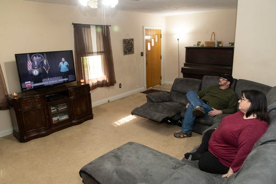 """Susan Miller and her husband, Bill Miller, watch an update by Gov. Andy Beshear on their television Tuesday. """"Over the weekend I just began really feeling scared,"""" Susan said. """"What does this mean? How long is this going to go on?"""" March 17, 2020"""