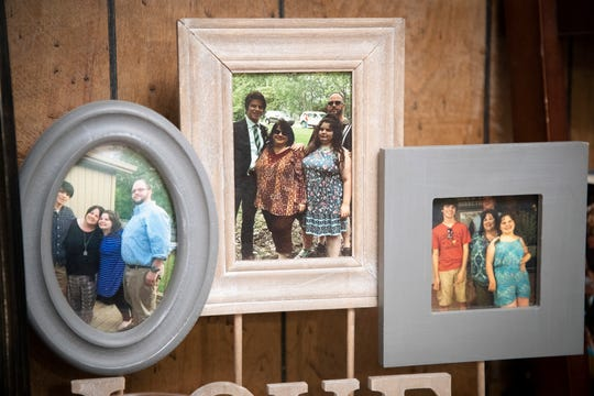 Family portraits on display in the Miller family living room. March 17, 2020