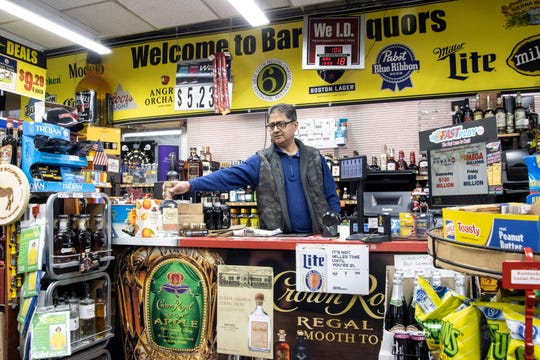 Barret Liquors owner Manoj Uppal has seen a spike in business as people practice social distancing at home and cope with the anxiety of an unknown future related to the coronavirus outbreak. 3/18/20