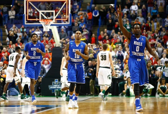 ST LOUIS, MO - MARCH 18: Perrin Buford #2, Jaqawn Raymond #10 and Darnell Harris #0 of the Middle Tennessee Blue Raiders leave the court after defeating the Michigan State Spartans during the first round of the 2016 NCAA Men's Basketball Tournament at Scottrade Center on March 18, 2016 in St Louis, Missouri.
