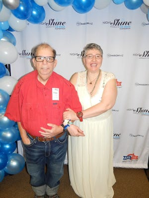 Frank LeVenia lost about 200 lbs walking and dancing the walking track at the YMCA. He's pictured here with wife Helen.