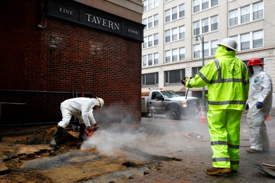 City crews work on fixing a water main break downtown that flooded the basement of Bardog Tavern on Wednesday, March 18, 2020.