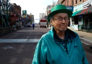 """In a green celebratory hat, Garth Knutson laments a subdued St. Patrick's Day on Beale Street Tuesday, March 17, 2020. """"we were prepared for St. Patricks Day, but there are not as many people as I thought there might be,"""" said Knutson. """" I stay home too much, I love being out."""""""