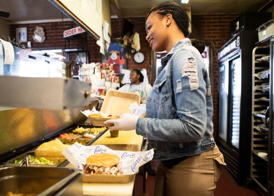 Central BBQ employee Khyra Cox prepares an order on March 18. Central is one of many Memphis restaurants suddenly reliant on takeout and delivery orders for business during the coronavirus crisis.