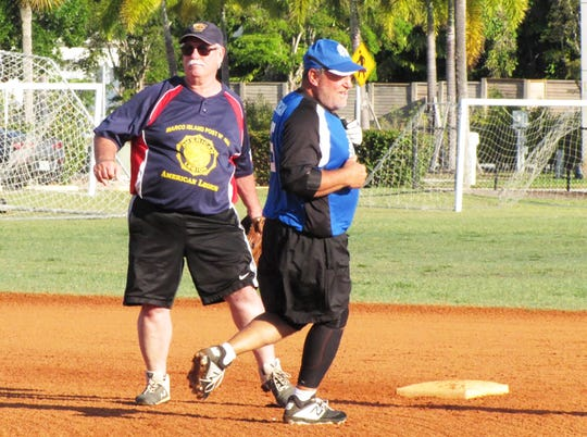 Peter Kane of the Brewery looks to see where the ball is as he rounds second base heading toward third base.