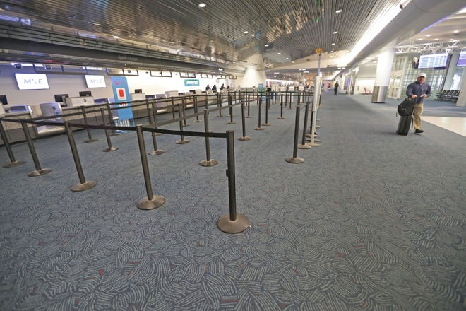 An empty ticketing area at Milwaukee Mitchell International Airport in Milwaukee is shown in this photo from March 18, 2020. Passenger traffic at Mitchell has rebounded somewhat from the lows it saw in March and April, but the numbers are only a fraction of what they were before the COVID pandemic resulted in a 70% decline in air travel compared to a year ago.