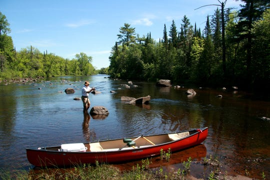 Mike Bartz of Spooner, Wis. fishes on the St. Croix River near Minong, Wis. Photo taken by Paul A. Smith.