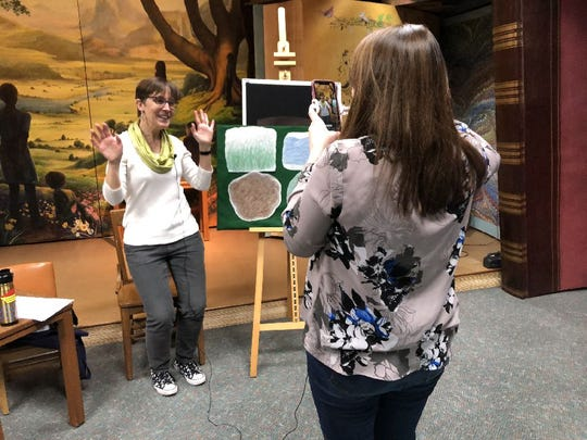 Maria Schmitt, a children's librarian with the Wauwatosa Public Library, is keeping her Rhyme Time story times alive on Facebook live.