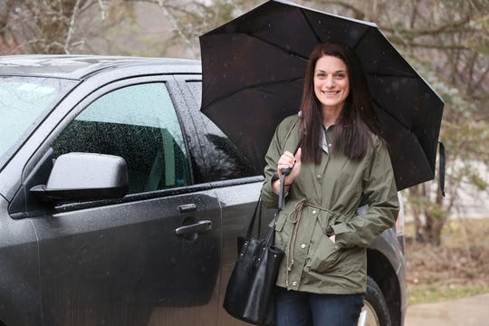 Wedding planner Heather Farr, shown outside her home in Franklin, is trying to figure out what to do with her brides and grooms set to tie the knot in the coming weeks and months.