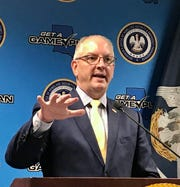 Gov. John Bel Edwards speaks during a March 18 press conference about the coronavirus crisis.