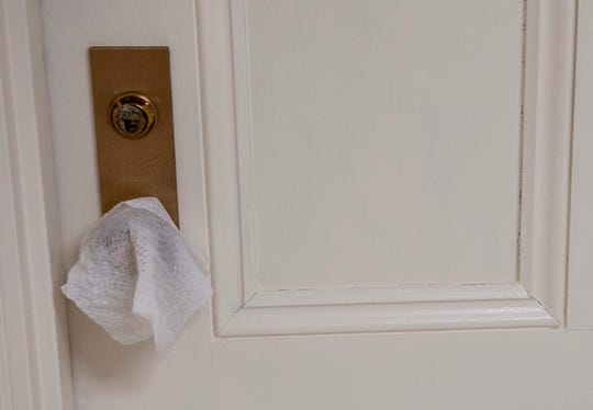 A disinfectant wipe rests on a door knob at the Alabama State Capitol in Montgomery, Ala., on Wednesday, March 18, 2020.