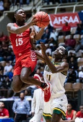 Lee's De'Marquiese Miles (15) shoots against Jeff Davis' Le'Tarion White (11) in AHSAA regional basketball action in Montgomery, Ala., on Tuesday February 18, 2020.