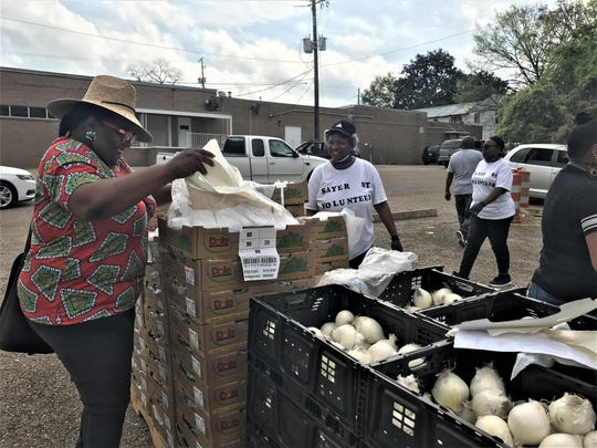 Michelle Browder volunteering at an emergency food giveaway Wednesday.