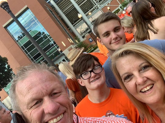 Tommaso Martinelli poses with his host family at an Auburn game.