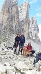 The Martinelli family poses on a mountainside in Italy.