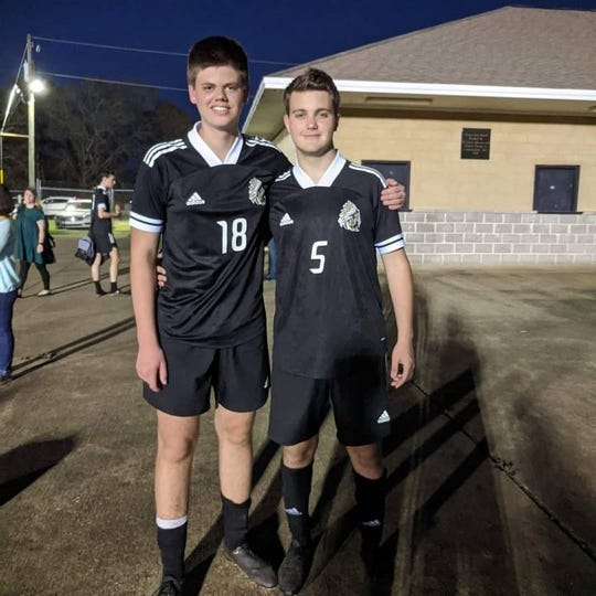Fabian Burmeister (left) and Tommaso Martinelli (right) poses for a picture after a soccer match.