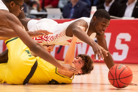 Lee's De'Marquiese Miles (15) and Mountain Brook's Alex Belt (21) go after a loose ball during the Class 7A boys state championship at Legacy Arena in Birmingham, Ala., on Saturday, Feb. 29, 2020. Lee defeated Mountain Brook 40-38.