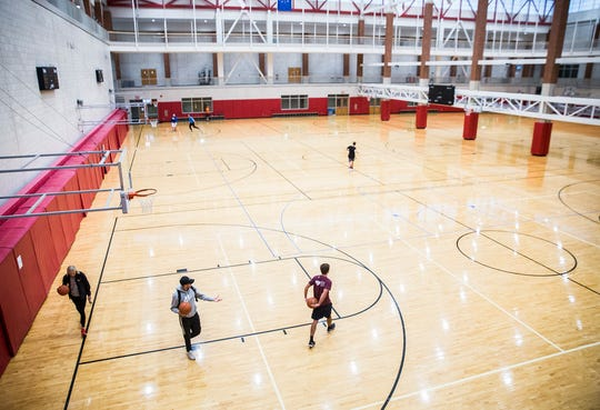 Several students play basketball at Ball State's recreation center Wednesday morning. With most gyms in the area closed due to coronavirus, few options remain for indoor recreation and exercise.