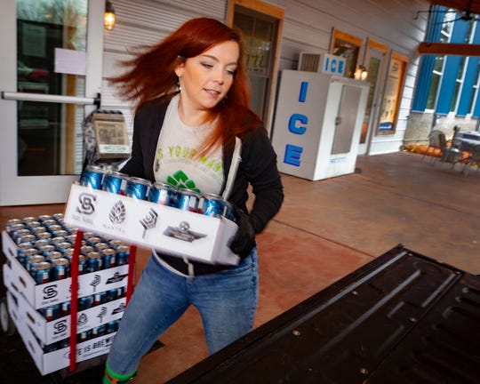 Miranda Hagen loads cases of Steel Barrel beer for a customer taking advantage of the deeply discounted rates at Hop Springs Beer Park. From 3 to 9 p.m. Wednesday through Friday, beer is being sold off at cost. Hundreds of cases are still available for purchase.